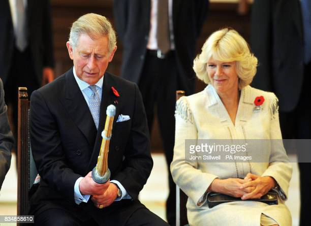 The Prince of Wales examines a Kendo practice Bamboo sword after he and the Duchess of Cornwall watched a Kendo sword demonstration at the Keio...