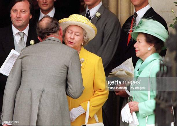 The Prince of Wales greets his mother Her Majesty the Queen with HRH Princess Margaret looking on at their arrival for the wedding of the late Earl...