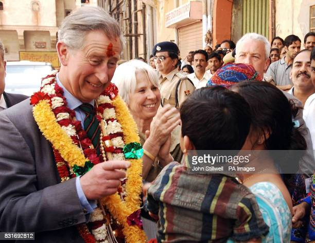 The Prince of Wales greets residents while touring the old city of Jaipur Friday March 31 2006 Charles's twoweek overseas tour with the Duchess of...