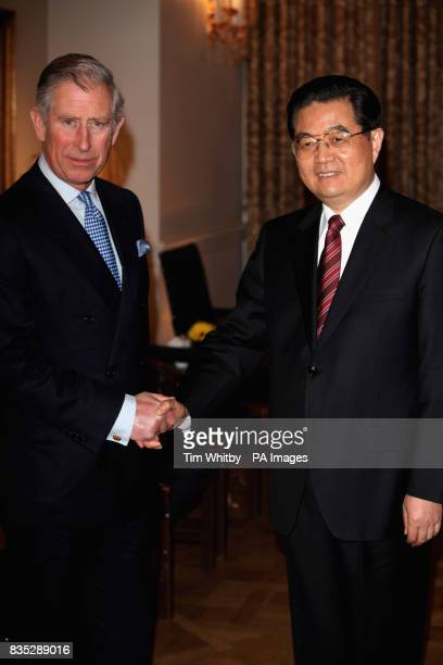 The Prince of Wales greets the Chinese President Hu Jintao during a meeting at The Mandarin Oriental Hotel London
