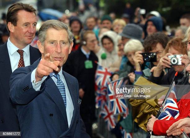 The Prince of Wales greets wellwishers during a visit to the JW Lees Brewery at Middleton near Manchester Members of the LeesJones family who still...
