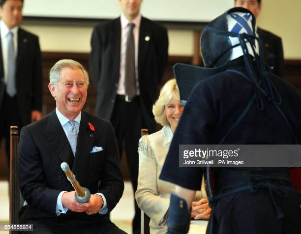 The Prince of Wales holds a Kendo sword during a demonstration he watched with the Duchess of Cornwall at the Keio University in central Tokyo this...