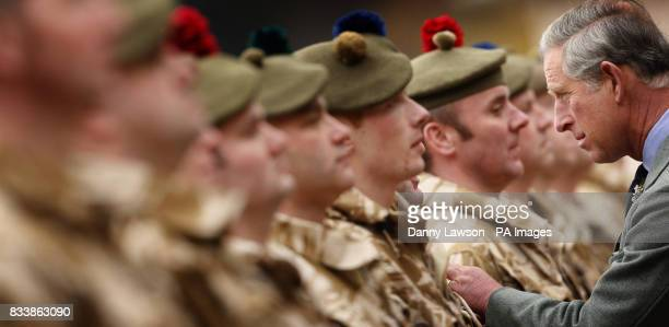 The Prince of Wales honours Territorial Army soldiers who served in Iraq during a presentation ceremony at his private Scottish home Birkhall