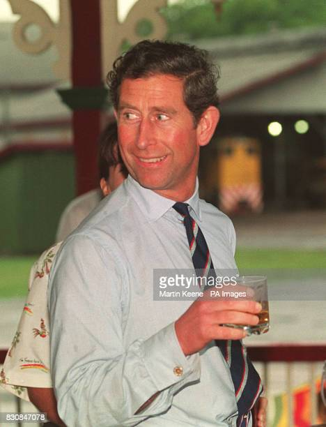The Prince of Wales in Bundaberg samples a glass of rum at the Bundaberg distillery