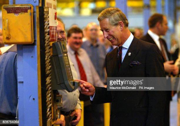 The Prince of Wales is amused as he looks on at a clocking on machine at the Weir Pumps in Cathcart Glasgow where he visited workers at Scotland's...