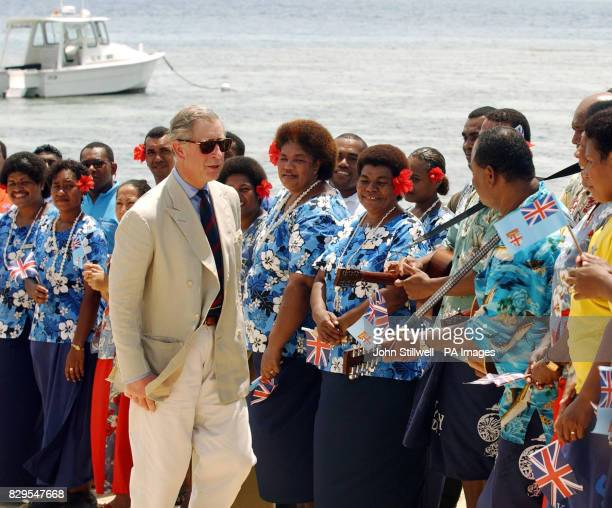The Prince of Wales is greeted by local residents