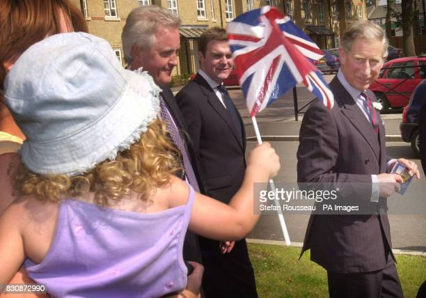 The Prince Of Wales is greeted by wellwishing residents at 'The Village' in Caterham Surrey an army barracks which has been converted into a housing...