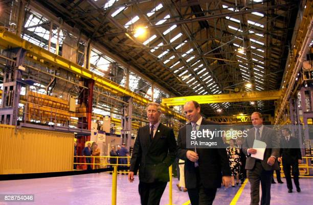 The Prince of Wales is guided through the factory at the Weir Pumps in Cathcart Glasgowwhere he visited workers at Scotland's largest engineering...