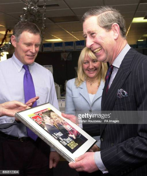The Prince of Wales is presented with a front cover of the TV Times which showed a photo of the Prince with the cast of Coronation Street on the...