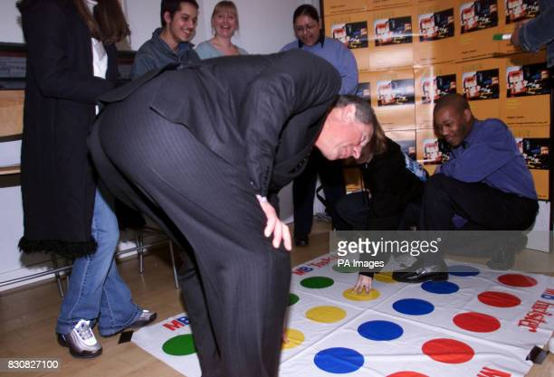 The Prince of Wales joins young people from Imagine London for a brief game of Twister during his visit to ''The Kings Fund' in London