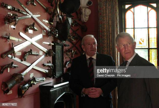 The Prince of Wales known officially as the Duke of Rothesay when in Scotland talks to Head Guide Rhoderich Scott during a visit to Abbotsford House...