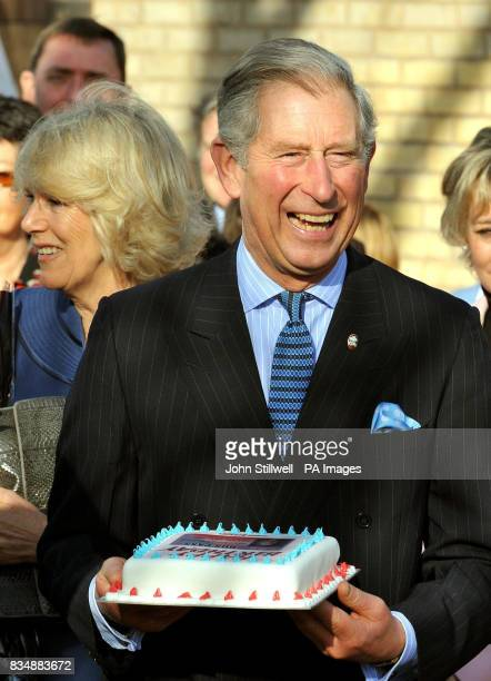 The Prince of Wales laughs out loud after he was presented with a birthday cake from staff at a national newspaper during a visit to a Prince's Trust...