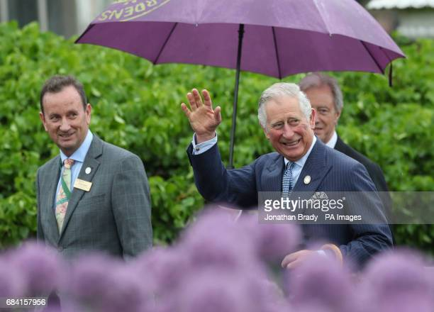 The Prince of Wales leaving the Palm House during his visit to the Royal Botanic Gardens at Kew Richmond Surrey