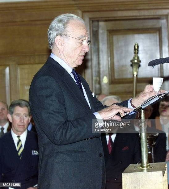 The Prince of Wales listens to Rupert Murdoch President of News Corp during a service at St Bride's Church in London's Fleet Street to celebrate 300...