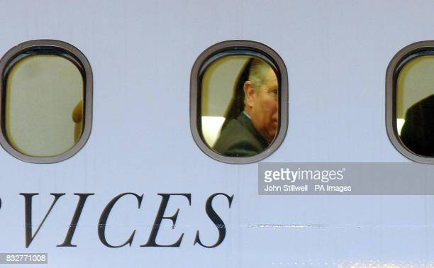The Prince of Wales looks out of his Plane window as he arrives at Kuwait International Airport this evening