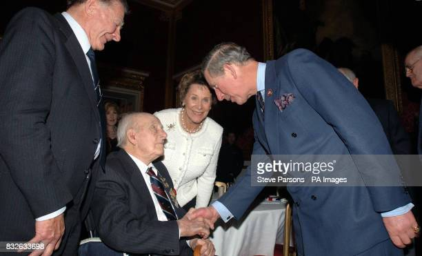 The Prince of Wales meets 110yearold Henry Allingham as he and the Duchess of Cornwall attend a reception for the 'Not Forgotten Association' at St...
