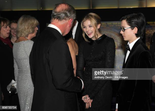 The Prince of Wales meets Chloe Moretz and the Duchess of Cornwall meets Helen McCroy as they attend the Royal Film Performance 2011 of Hugo at the...