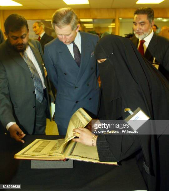 The Prince of Wales meets Deputy Director of the Islamic Foundation Chowdhury MueenUddin and Librarian Amna BintIsmael during a visit to the...