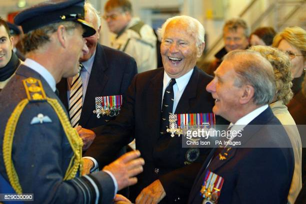 The Prince of Wales meets Norman Wilkins Des Butters and Bob Hide part of a former World War Two Lancaster bomber crew at RAF Odiham in Hampshire...