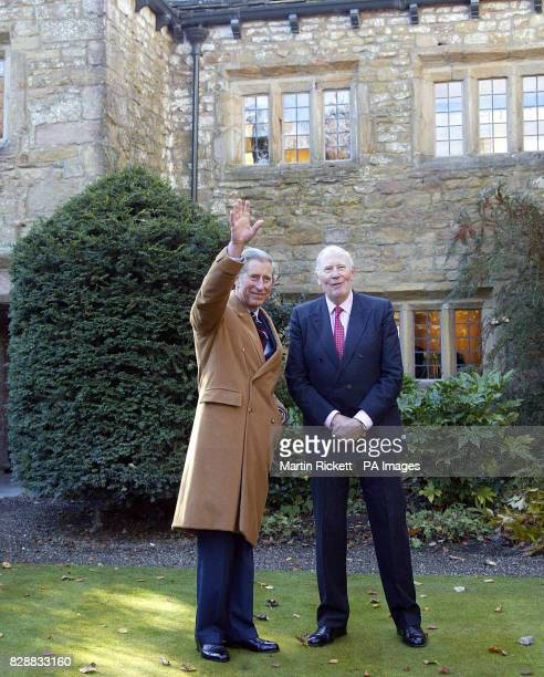 The Prince of Wales meets Sir Roger Bannister outside some renovated farm buildings in which Sir Roger's descendants used to live part of the Pendle...