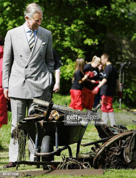 The Prince of Wales observes how a Prince's Trust project is improving the local environment at Niddrie Burn in the Craigmillar area of Edinburgh