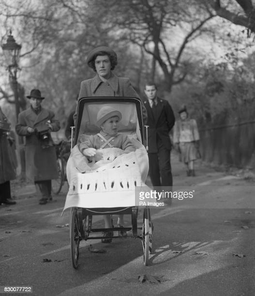 The Prince of Wales on a second birthday outing in St James's Park London with nanny Mabel Anderson