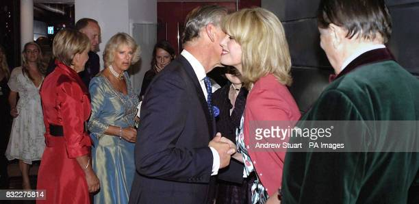 The Prince of Wales Patron of mental health charity SANE meets Joanna Lumley as the Duchess of Cornwall and Barry Humphries look on at the John...