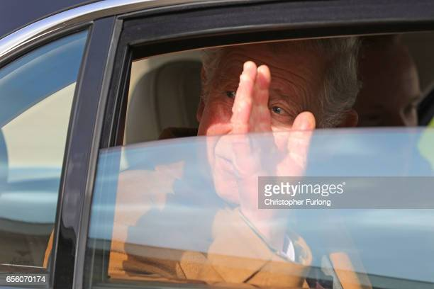 The Prince of Wales Patron of The Specialist Cheesemakers Association waves goodbye after visiting Dewlay Cheesemakers on March 21 2017 in Preston...