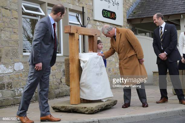 The Prince of Wales Patron of The Specialist Cheesemakers Association unveils a plaque during his visit to Dewlay Cheesemakers on March 21 2017 in...