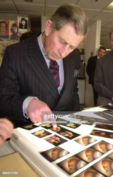 The Prince of Wales Picture looks at pictures of Kirsty Young and Carol Vorderman on a lightbox during his visit to the offices of IPC Media in...