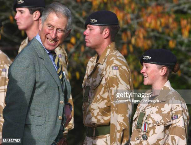 The Prince of Wales presents a service medal to Lance Cpl Sarah Stewart a member of the Queen's Own Yeomanry at the royal residence of Birkhall near...