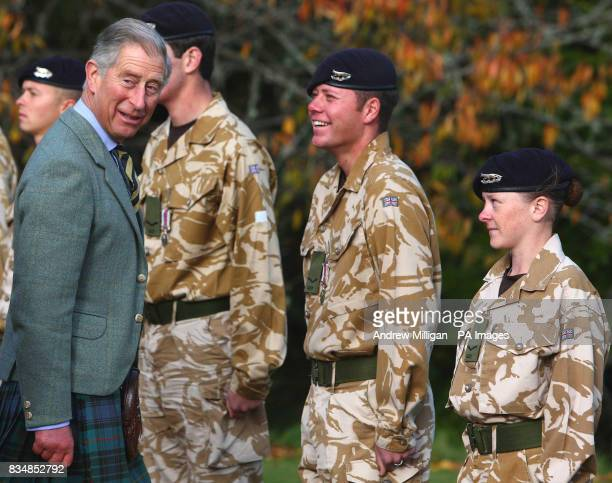 The Prince of Wales presents service medals to members of the Queen's Own Yeomanry at the royal residence of Birkhall near Ballater Aberdeenshire