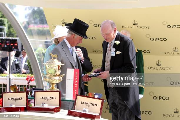 The Prince of Wales presents trainer John Gosden with a trophy after The Fugue won the Prince of Wales's Stakes during Day Two of the 2014 Royal...