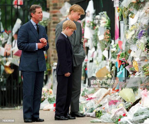 The Prince of Wales Prince William and Prince Harry look at floral tributes to Diana Princess of Wales outside Kensington Palace on September 5 1997...