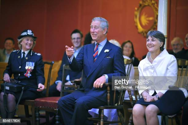 The Prince of Wales reacts to a joke as he sits waiting for a concert performance to begin with Chief Constable for South Wales Barbara Wilding and...