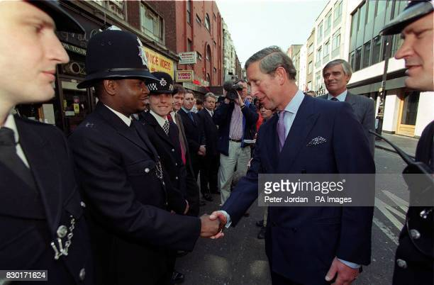 The Prince of Wales shakes hands with one of the first police constables to arrive at the scene of the nail bomb blast in the Admiral Duncan pub on...