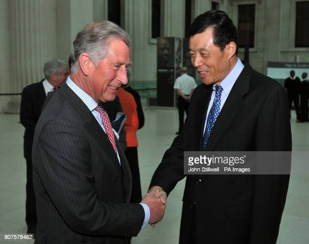 The Prince of Wales shakes hands with the Chinese Ambassador His Excellency Mr Xiaming Liu after arriving for the premiere of The Emperor's Secret...