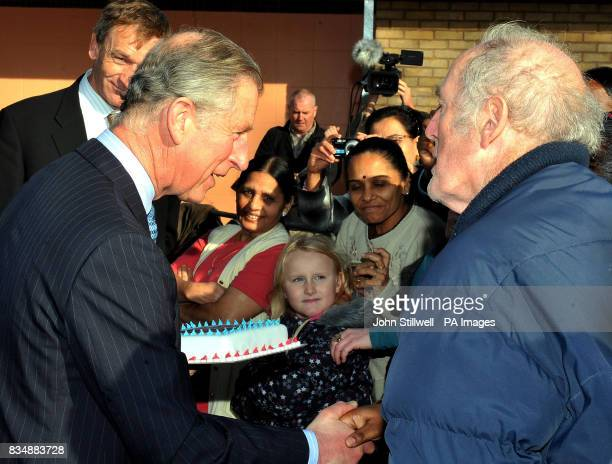 The Prince of Wales shakes hands with well wishers as he leaves after a visit to a Prince's Trust project at Beckton Community Centre in east London