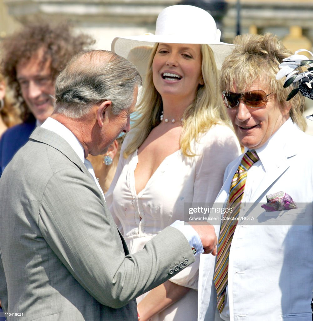 HRH The Prince of Wales shares a joke with 'Celebrity Ambassadors' Rod Stewart and Penny Lancaster at a Buckingham Palace Garden party in London, July 14, 2006, in honour of Celebrity Ambassadors and staff of The Princes Trust. The party was held as part of the anniversary celebrations for The Princes Trust Charity.