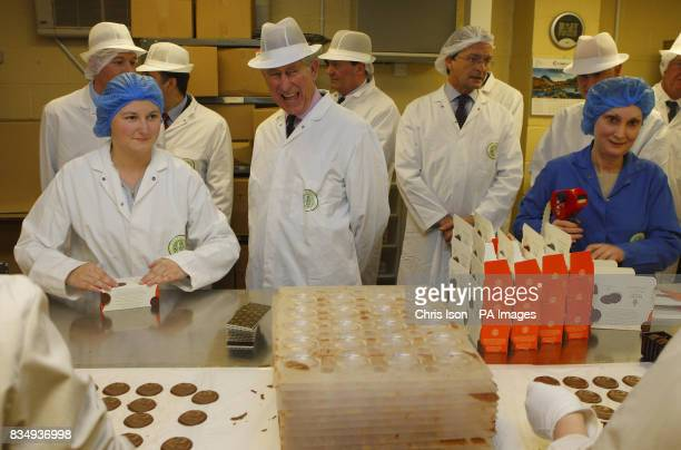 The Prince of Wales shares a joke with staff packing Duchy Original biscuits at the Dorchester Chocolate Factory in Poundbury Dorset