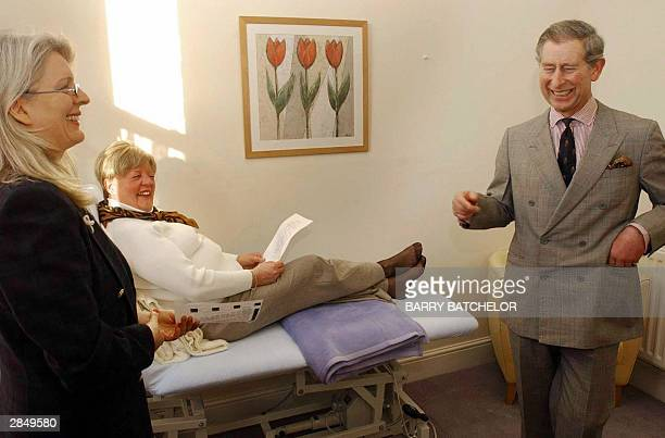 The Prince of Wales shares a joke with therapist Nadia Brydon and patient Julia Higgs during his visit to the Haven Trust's therapy centre for...