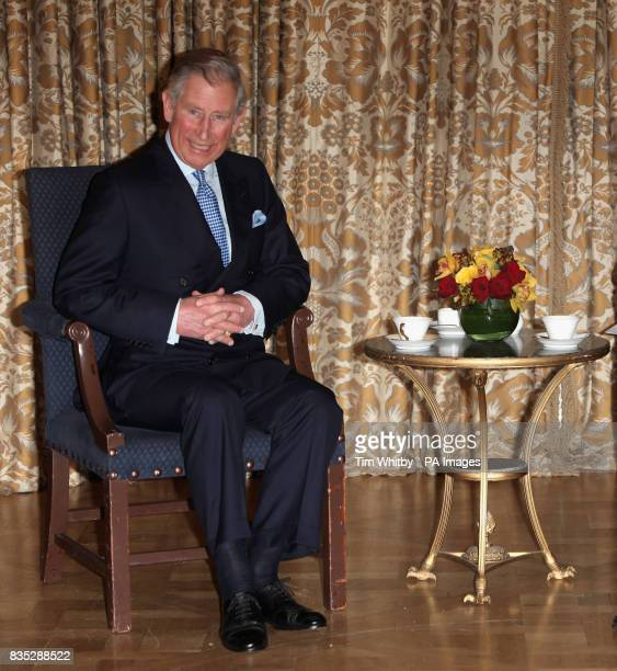The Prince of Wales speaks with the Chinese President Hu Jintao during a meeting at The Mandarin Oriental Hotel London