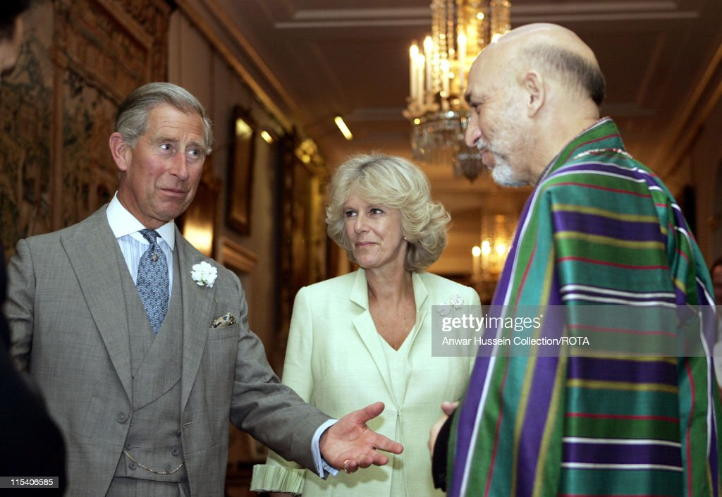 The Prince of Wales stands with <a gi-track='captionPersonalityLinkClicked' href=/galleries/search?phrase=Camilla+-+Duchess+of+Cornwall&family=editorial&specificpeople=158157 ng-click='$event.stopPropagation()'>Camilla</a>, Duchess of Cornwall, and visiting Afghanistan's President <a gi-track='captionPersonalityLinkClicked' href=/galleries/search?phrase=Hamid+Karzai&family=editorial&specificpeople=121540 ng-click='$event.stopPropagation()'>Hamid Karzai</a> as they pose for photographers prior to their talks in London, Tuesday July 19, 2005. Karzai is in London on an official visit.