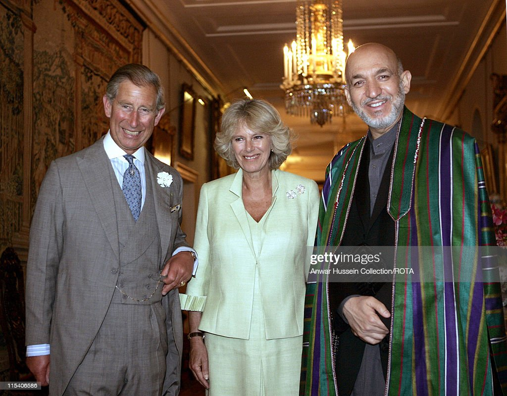 The Prince of Wales stands with <a gi-track='captionPersonalityLinkClicked' href=/galleries/search?phrase=Camilla+-+Duquesa+da+Cornualha&family=editorial&specificpeople=158157 ng-click='$event.stopPropagation()'>Camilla</a>, Duchess of Cornwall, and visiting Afghanistan's President <a gi-track='captionPersonalityLinkClicked' href=/galleries/search?phrase=Hamid+Karzai&family=editorial&specificpeople=121540 ng-click='$event.stopPropagation()'>Hamid Karzai</a> as they pose for photographers prior to their talks in London, Tuesday July 19, 2005. Karzai is in London on an official visit.