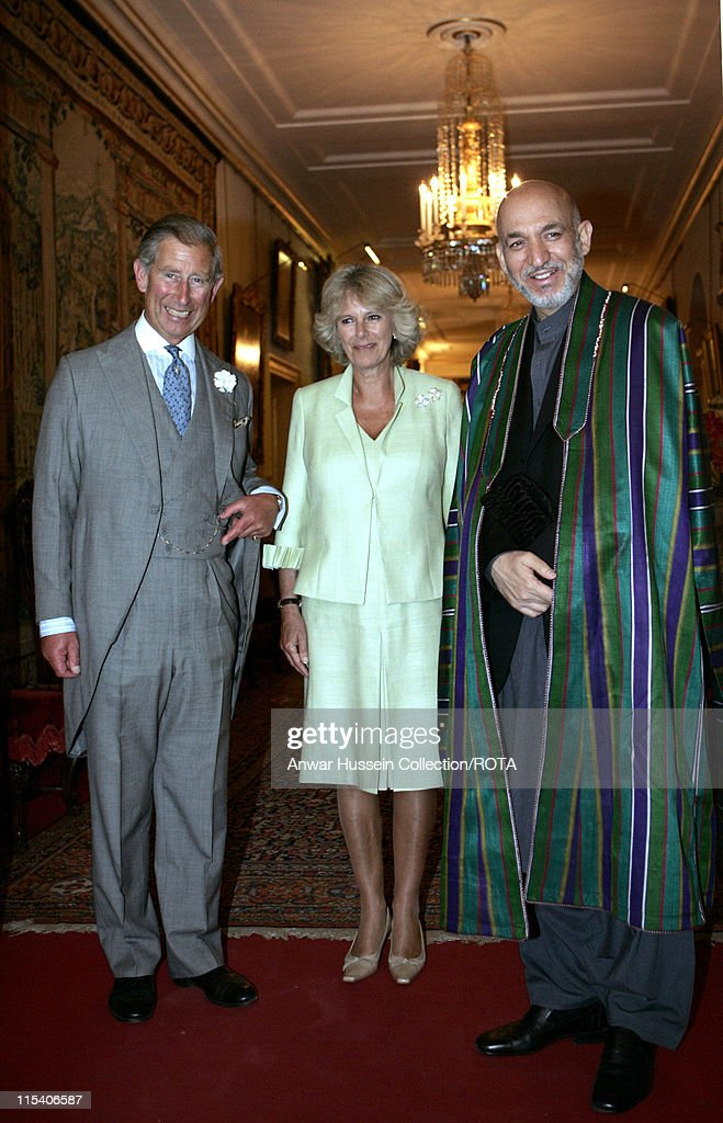 The Prince of Wales stands with <a gi-track='captionPersonalityLinkClicked' href=/galleries/search?phrase=Camilla+-+Hertogin+van+Cornwall&family=editorial&specificpeople=158157 ng-click='$event.stopPropagation()'>Camilla</a>, Duchess of Cornwall, and visiting Afghanistan's President <a gi-track='captionPersonalityLinkClicked' href=/galleries/search?phrase=Hamid+Karzai&family=editorial&specificpeople=121540 ng-click='$event.stopPropagation()'>Hamid Karzai</a> as they pose for photographers prior to their talks in London, Tuesday July 19, 2005. Karzai is in London on an official visit.