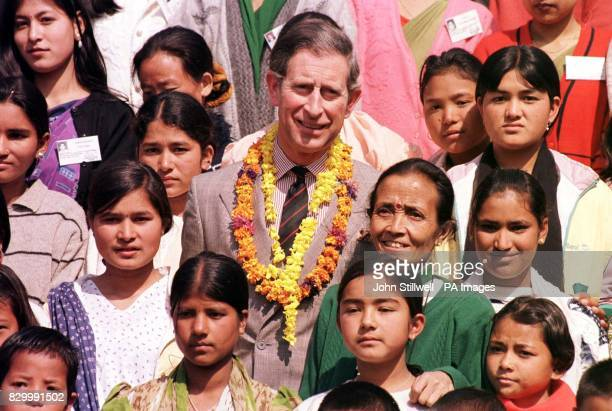 The Prince of Wales stands with girl's from the Maiti Nepal Refuge Home in Kathmandu following his visit to the centre earlier today The shelter...