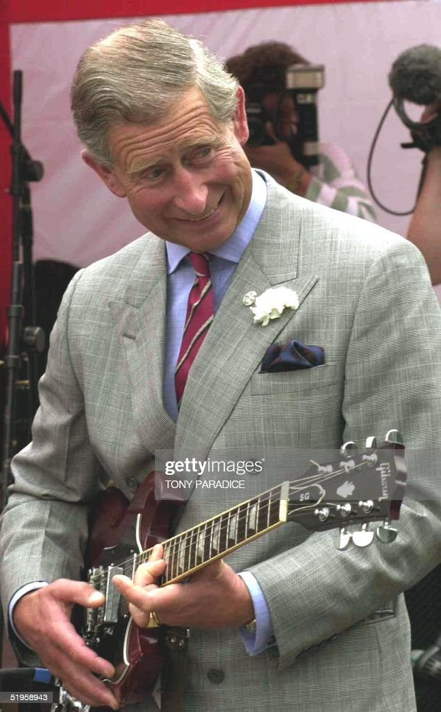 The Prince of Wales struck a chord with youngsters when he strummed a guitar during a visit to young people and volunteers involved in projects helped by The Prince's Trust Cymru, 19 July 2002. The Prince hit the right note when he borrowed a guitar belonging to a young member of a band which had been formed after completing a recent music course at Rhayader in mid Wales.