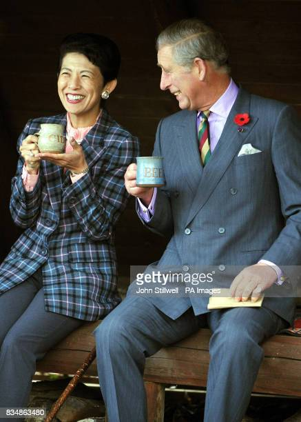 The Prince of Wales takes tea with Princess Takamado during a visit to the Afan Forest near the village of Shinanomachi in central Japan