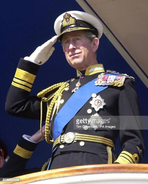 The Prince of Wales takes the salute of the cadets as he inspects a parade of 183 Officers who graduated from the Britannia Royal Naval Collage in...