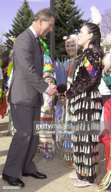The Prince of Wales talks to a Cree woman in Saskatchewan Canada shortly before dancing with a Cree man The Prince was in the Canadian province of...
